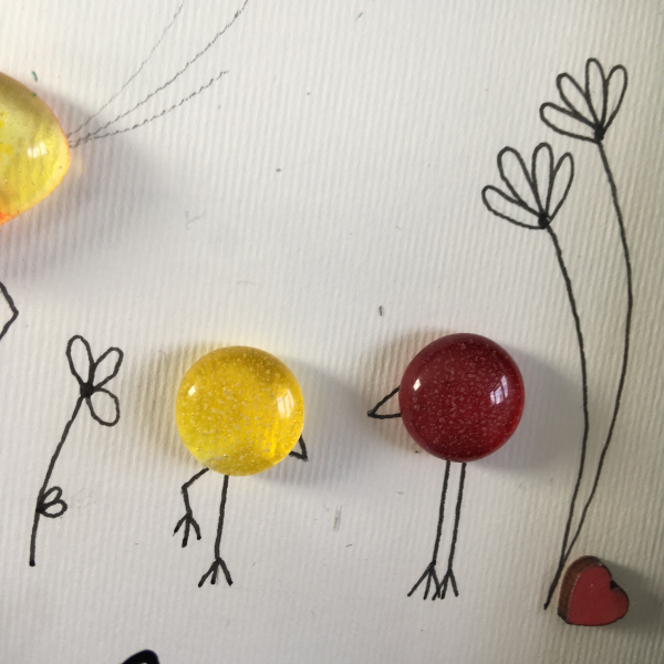 yellow and orange fused glass bird family with line drawn flowers